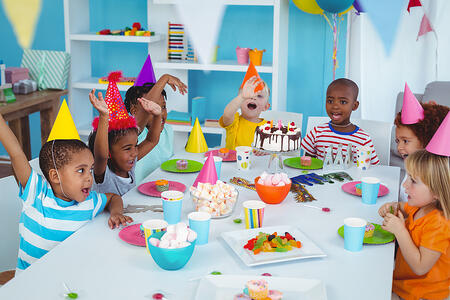 Excited kids enjoying a birthday party together