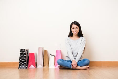 Woman with shopping bag in home