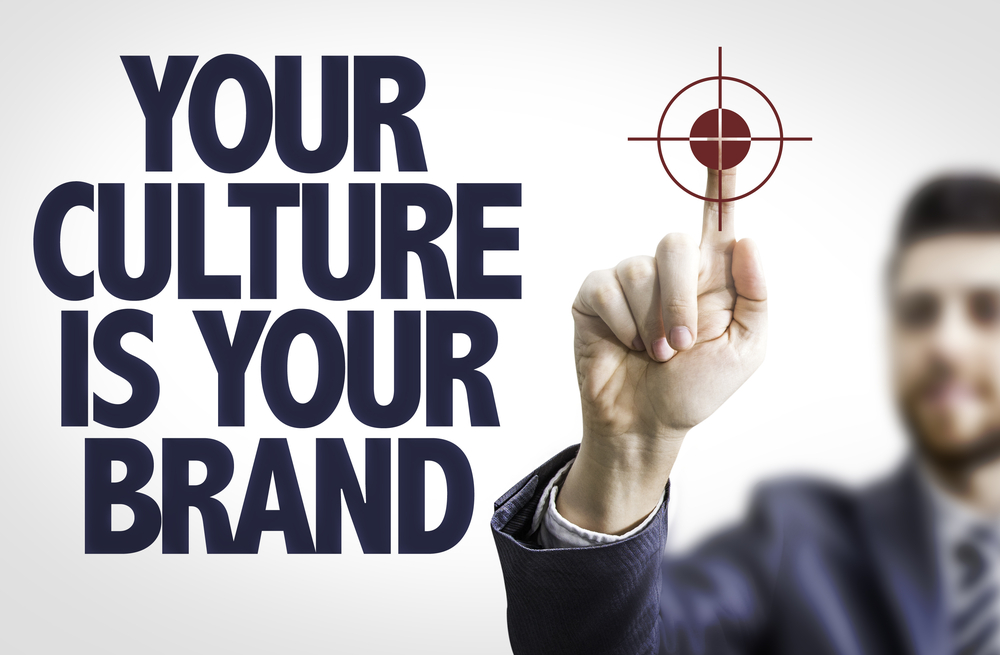 Business man pointing the text Your Culture is Your Brand