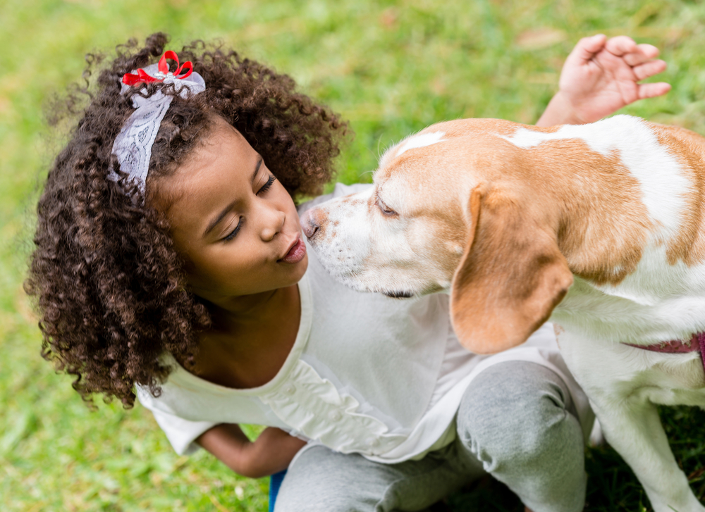 Portrait of a beautiful girl with a cute dog